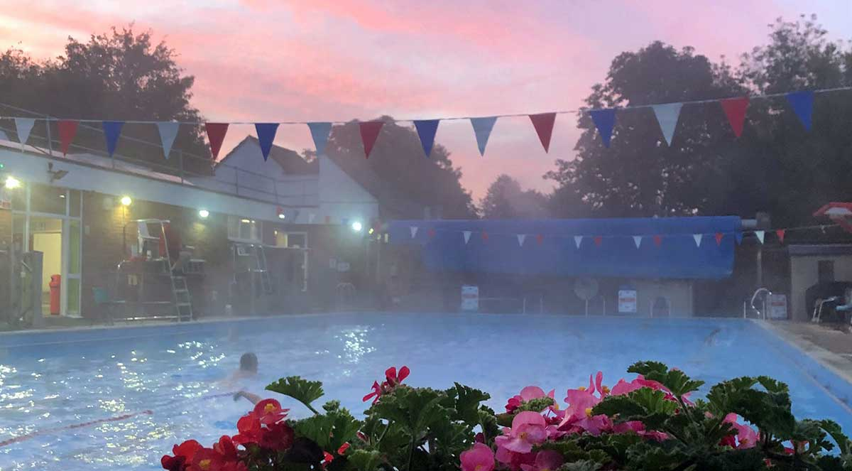 Pink sunrise and flowers, Chesham outdoor pool