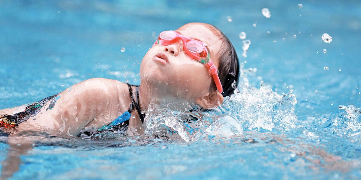 child swimming well